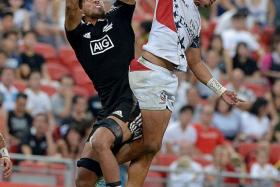 TIGHT TUSSLE: All Blacks' Regan Ware (left) and USA's Maka Unufe vying for the ball. New Zealand won 19-12.