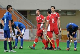 SO CLOSE: SIngapore captain Enrico Marican (far left) had the best chance after racing past four defenders, but he could only blast his shot wide.