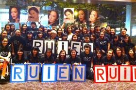 SUPPORT: Rui En (above, in white) with the members of her fan club, RBKD, at the Star Awards 2014.