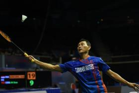 Sony Dwi Kuncoro of Indonesia hits a return shot against Lin Dan of China during their men's singles semi-final badminton match at the Singapore Open in Singapore on April 16, 2016.