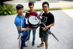 TEAMWORK: The SUTD team and their Unmanned Aerial Vehicle.