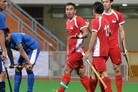 AMATEUR HOUR: Singapore captain Enrico Marican (third from right) said that his team were amateurish in their 3-1 World League Round 1 defeat by Thailand.