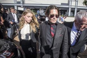 "SMUGGLE: (From left) The ""war on terrier"" started when US actress Amber Heard was discovered to have brought two dogs to Australia without declaring them. She was visiting husband, US actor Johnny Depp, who was filming the latest Pirates Of The Caribbean movie."