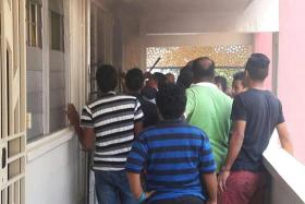 DRAMA: More than 10 residents gathered outside the elderly man's flat to try to break into his unit.