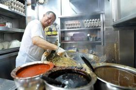 DEDICATED: Mr Ng Chin Chye (above) has been cooking char kway teow for 35 years at his stall, Outram Park Fried Kway Teow, which is now at Hong Lim Market & Food Centre.