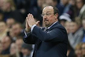 SURVIVORS: Rafa Benitez (above) has instilled resilience in Newcastle, whose players like Papiss Demba Cisse battled to win a point against Manchester City.