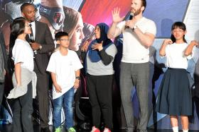 Captain America's Chris Evans answering Nur Qumaira Adam's (far left) question about loving Singapore as much as Singapore loves him.