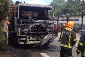 BURNT: Fire engulfed a tipper truck at the AYE yesterday and destroyed the front of the vehicle (above).