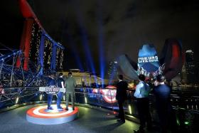 LIGHT IT UP: Above) The movie's stars, who included Chris Evans, Anthony Mackie and Sebastian Stan launching the #TeamCap light and fireworks display yesterday.