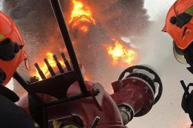 EFFICIENT: (Above) The large foam monitor used to mitigate the fire can shoot out 27,000 litres of foam per minute.