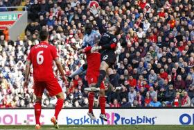 CRUCIAL: A mistake by Liverpool goalkeeper Simon Mignolet allowed Newcastle's Papiss Cisse (centre) to score their first goal which sparked their revival.