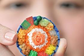 BITE-SIZED: Mrs Juliana Lim with a miniature yusheng platter.