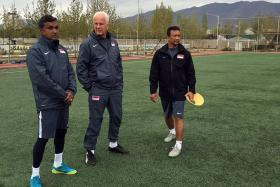 UNDERSTUDY: V Sundramoorthy (left) and Fandi Ahmad (right) have regularly assisted former national coach Bernd Stange (centre) on international assignments over the last 16 months when the German was in charge.