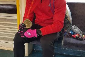 211TH OVERALL: Soh Rui Yong posing with his London Marathon finisher's medal yesterday.