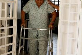 LIFE CHANGED: She now uses a walker to get around in her flat in Tampines.
