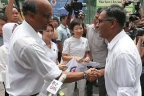 PAP: Deputy Prime Minister Tharman Shanmugaratnam (left) congratulating Mr Murali Pillai on filing his nomination papers.