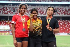 SILVER SHINE: (From left) Singapore's Shanti Pereira with the 100m winner, Malaysia's Komalam Shally Selvaratnam, and bronze-medallist Siti Fatimah.