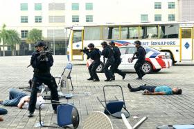 FIRST: ERT officers in a simulated terrorist attack yesterday.