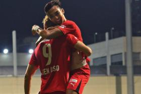 JOY: Home's Ken Ilso (No. 9) getting a hug from Faris Ramli after scoring the first goal.