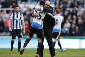 Rafael Benitez (above, hugging goalscorer Andros Townsend)
