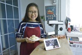 PASSION: Ms Ng Jia Jia in her kitchen, where she produces homemade baked goods for sale on online platform HomeBakee.