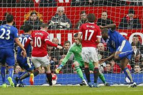 CAPTAIN TO THE RESCUE: Wes Morgan's (above right) equaliser edges Leicester closer to the EPL title.