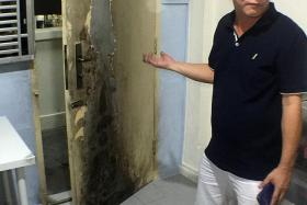 DESTRUCTION: The fire damaged Mr Richard Tan's front door and metal gates. Some shoes were also ruined.