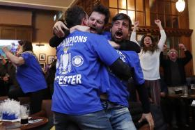 Fans celebrate  in pub in Leicester as the Chelsea v Tottenham Hotspur game ends in a draw