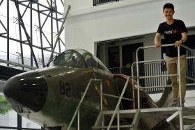 TOP GUN: Mr Lionel Lee, with an A4SU Super Skyhawk in Singapore Polytechnic's Aero Hub, is passionate about mathematics.