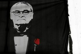 IN RANIERI WE TRUST: A banner with Claudio Ranieri's image is displayed proudly in the King Power Stadium during their 4-0 win over Swansea last month.