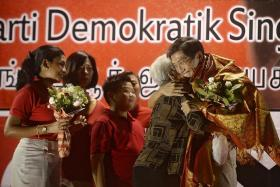 FAMILY: SDP's Dr Chee Soon Juan hugging his mother.