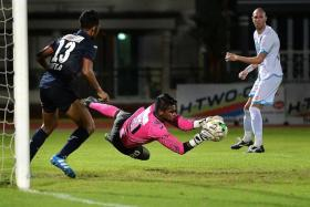 DENIED: Rookie Warriors goalkeeper Zainol Gulam making yet another big save to help his side to a draw against DPMM.