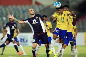 SHOCK DEFEAT: Billy Mehmet (No. 25) and his Tampines teammates lost 3-2 to Sheikh Jamal Dhanmondi (in yellow) in their last AFC Cup match.