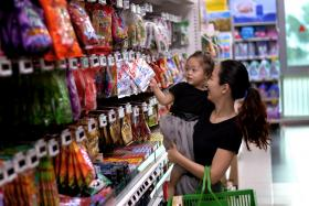 Miss Christabel Koh, 28, works as a shopper for Honestbee and brings her daughter along with her to work.