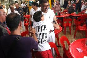 TOUGH FIGHT: (Above) Mr Murali Pillai meeting supporters after winning the Bukit Batok by-election yesterday.
