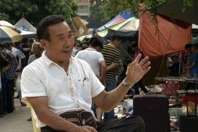 OLD IS GOLD: Mr Koh Eng Khoon sharing his story as a street peddler at Sungei Road.