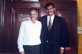 INSPIRED: Mr Muralidharan Pillai with his father P.K. Pillai in a 1996 photo (above).