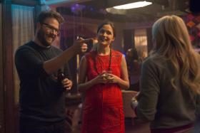 Rose Byrne (centre) with Seth Rogen (left) and Chloe Grace Moretz (right) in Bad Neighbours 2.