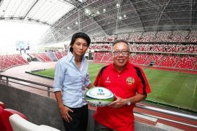BRAINS TRUST: Singapore Rugby Union president Low Teo Ping and national women's team head coach Wang Shao-Ing.