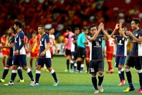 WELL DONE: The Tampines players saluting the crowd after becoming the first S.League team to play at the National Stadium.