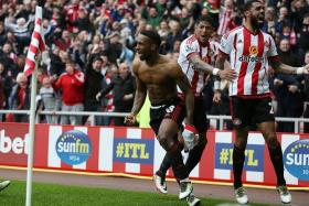 COOL CAT: Jermain Defoe (above left) has scored five 