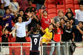 STAGS' SUPPORT: Tampines Rovers star Jermaine Pennant (above) interacting with the fans.