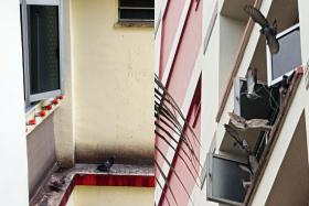 PIGEON HOLD: (Right) A resident of Block 628, Pasir Ris Drive 3, has been tying pigeons by their legs with string to her kitchen window, and residents have been complaining about the smell and the droppings (left).