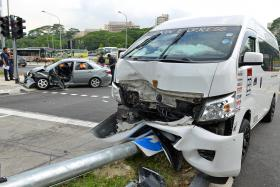 CRASH: A car and a van were badly damaged after colliding at a Woodlands junction, leaving one woman with suspected spinal injuries.