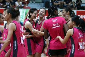 JUBILATION Blaze Dolphins (above) celebrate their win over the Sneakers Stingrays in the M1 Netball Super League (NSL) final.