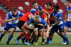 NO WAY THROUGH: Stormers lock Pieter- Steph Du Toit (with the ball) trying to find a breakthrough as the Sunwolves stand firm in defence.
