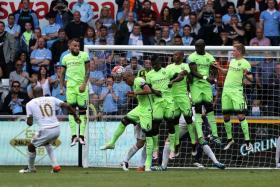 CITY CONCEDE: Fernando (No. 6) deflecting Andre Ayew's free-kick into goal.