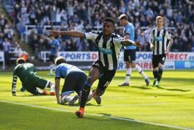 Rolando Aarons celebrates scoring the fourth goal for Newcastle United