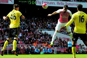 HEAD BOY: In-form Olivier Giroud scores his first of three goals in the game for Arsenal against relegated Villa at the Emirates Stadium.
