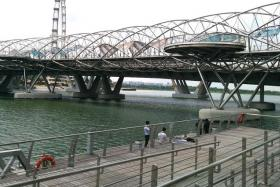 MOTIONLESS: The woman who was found face down in the Marina Bay was not breathing and had no pulse before she was resuscitated by an ambulance crew.